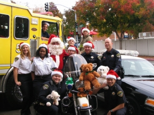 Santa Cop In front of fire truck and police motorcycle